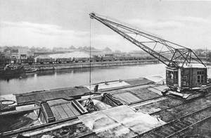 Unloading brewing barley at the docks in Dortmund, opened by Emperor Wilhelm II in 1899 and now the largest canal port in Europe.