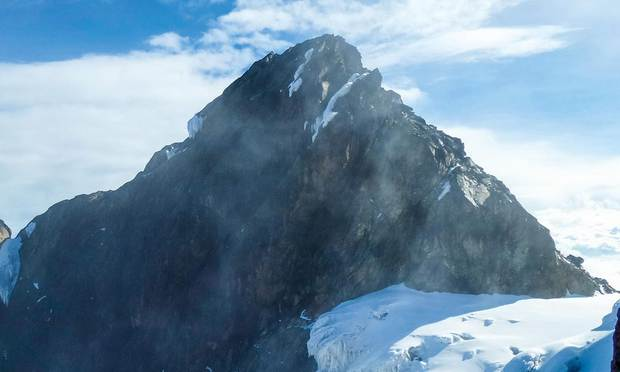 Snow and ice cover parts of Margherita Peak, the highest summit in the Mount Stanley Massif in Uganda's Rwenzori Mountains.