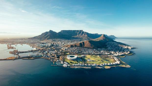 The South African metropolis of Cape Town, with its bustling harbor and soccer stadium built for the 2010 FIFA World Cup, elegantly sprawls at the foot of impressive Table Mountain.